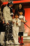 """Tokyo, Dec. 30, 2009 - Nakai MASASHIRO, Seishiro KATO, Yukie NAKAMA and Nozomi OHASHI (from L to R) are photographed during the second day of rehearsals for 'Kohaku Uta Gassen,' or also more commonly known as 'Kohaku.' Produced by the Japanese public broadcaster, NHK, this annual music show airs on New Year's Eve and ends shortly before midnight, where everyone on air pauses to say """"Happy New Year."""" The 'Red and White Song Battle' separates the most popular music artists during each given year into teams of red and white: the red team consists of all female artists and the white team is all male artists. For an artist to perform on Kohaku, it is a great honor as only the most successful enka singers and J-Pop artist are strictly invited to perform by invitation only. Today, for a J-Pop artist or enka singer to perform on Kohaku, is most notably recognized to be a big highlight in a singer's career due to the show's large reach of audience during New Year's Eve."""