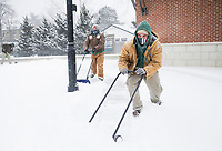 Bentonville Parks and Recreation Sanitation Crew Leader Chris Flores (right) and Trails Maintenance crew member Jorge Chavez (left) plow snow, Monday, February 15, 2021 at Lawrence Plaza in Bentonville. Check out nwaonline.com/210216Daily/ for today's photo gallery. <br /> (NWA Democrat-Gazette/Charlie Kaijo)