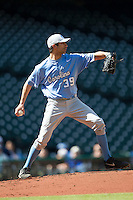 North Carolina Tar Heels starting pitcher Benton Moss #39 makes a pickoff throw to second base against the California Golden Bears in the NCAA baseball game on March 2nd, 2013 at Minute Maid Park in Houston, Texas. North Carolina defeated Cal 11-5. (Andrew Woolley/Four Seam Images).