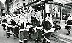 "A car full of joyful Santa's who just graduated from ""Santa School"" was found stepping off a California Street Cable Car near Market Street in San Francisco, California."