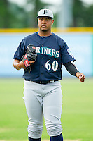 Pulaski Mariners starting pitcher Luiz Gohara (60) warms up in the outfield prior to the game against the Burlington Royals at Burlington Athletic Park on July 20, 2013 in Burlington, North Carolina.  The Royals defeated the Mariners 6-5.  (Brian Westerholt/Four Seam Images)