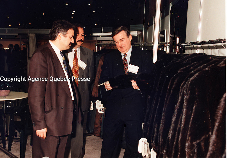 Montreal (Qc) Canada  file Photo - 1995 - Pierre Bourque, Montreal Mayor, (R)  talk with furriers at the North American Fur and Fashion Exhibit of Montreal, NAFFEM