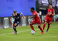LAKE BUENA VISTA, FL - JULY 26: Jesús Medina of New York City FC attacks the wing while defended by Richie Laryea of Toronto FC as Marco Delgado of Toronto FC looks on during a game between New York City FC and Toronto FC at ESPN Wide World of Sports on July 26, 2020 in Lake Buena Vista, Florida.