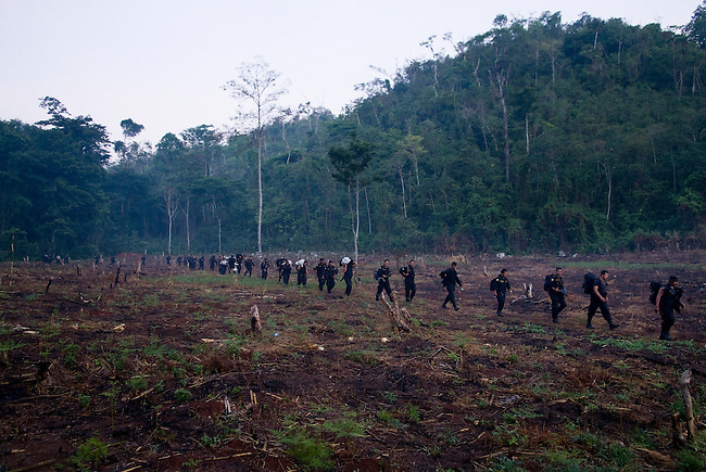 """Guatemala, Petén, Mayan Biosphere Reserve, Land Conflicts, Eviction operation in """"Sierra del Lacandón"""" park. The operations only affect despered farmers who often work for wealthy ranchers those want to turn the protected area into cattle ranching land. The expensive evictions have little long term results as long as the root problems are not adressed and settlers come back after military has left."""