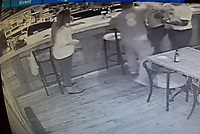 2019 09 27 CCTV still showing the assault at The Lounge in Bridgend, Wales, UK.