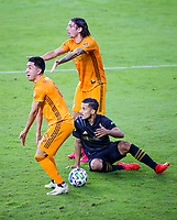 CARSON, CA - OCTOBER 28: Memo Rodriguez #8 and Zarek Valentin #4 of the Houston Dynamo and Mohamed El-Munir #13 of the Los Angeles FC look for answers from the ref during a game between Houston Dynamo and Los Angeles FC at Banc of California Stadium on October 28, 2020 in Carson, California.