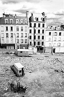 Demolished buildings at a construction site.