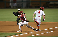 Arkansas infielder Cullen Smith (14) forces out Nebraska infielder Max Anderson (4), Saturday, June 5, 2021 during the fourth inning in the second game of the NCAA Fayetteville Regional at Baum-Walker Stadium in Fayetteville. Check out nwaonline.com/210606Daily/ for today's photo gallery. <br /> (NWA Democrat-Gazette/Charlie Kaijo)
