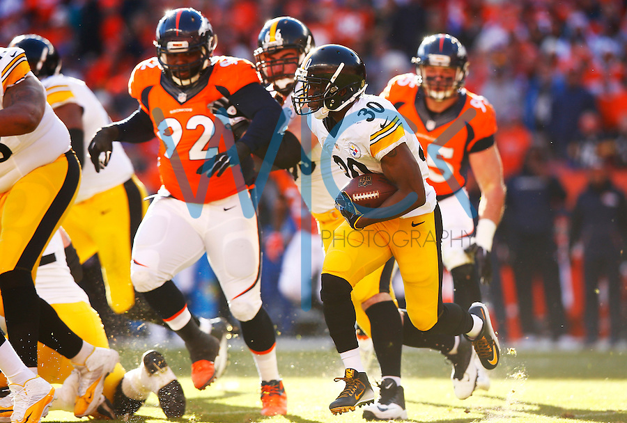 Jordan Todman #30 of the Pittsburgh Steelers carries the ball against the Denver Broncos during the AFC Divisional Round Playoff game at Sports Authority Field at Mile High on January 17, 2016 in Denver, Colorado. (Photo by Jared Wickerham/DKPittsburghSports)