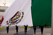 Mexico City, Mexico<br /> June 16, 2008<br /> <br /> A large Mexican flag is lifted into place during the opening ceremonies of a new federal police center. The first of ten scheduled to open around the country.