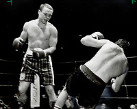 Challenger Roddy MacDonald watches as champion Gary Summerhays heads for the canvas duing their Canadian light heavyweight championship fight last night at the CNE Coliseum. MacDonald's youth and strength ended the eight-year reign of Summerhay