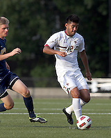 Boston College defender/forward Kevin Mejia (12) at midfield. Boston College defeated Quinnipiac, 5-0, at Newton Soccer Field, September 1, 2011.