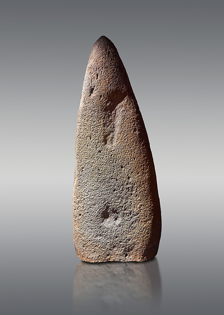 Late European Neolithic prehistoric Menhir standing stone which represents a standing figure. Excavated from Bau Carradore III site,  Laconi. Menhir Museum, Museo della Statuaria Prehistorica in Sardegna, Museum of Prehoistoric Sardinian Statues, Palazzo Aymerich, Laconi, Sardinia, Italy. Grey background.