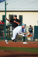 Daytona Tortugas first baseman Brian O'Grady (12) fields a ground ball as umpire J.C. Velez signals fair during a game against the Fort Myers Miracle on April 17, 2016 at Jackie Robinson Ballpark in Daytona, Florida.  Fort Myers defeated Daytona 9-0.  (Mike Janes/Four Seam Images)