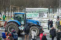 """""""Wir haben es satt!""""-Protest am Samstag den 16 Januar 2021 in Berlin.<br /> Im Bild: Bauern und Baeuerinnen aus Berlin und Brandenburg, sowie Mitglieder von Umweltschutzorganisationen protestierten mit mehreren dutzend Traktoren vor dem Bundeskanzleramt um fuer eine gerechtere Agrarpolitik zu demonstrieren. Sie forderten eine Politik fuer den Erhalt ihrer Hoefe, eine Politik fuer artgerechte Tierhaltung und konsequenten Klimaschutz.<br /> Da aufgrund der Corona-Pandemie die Demonstration nicht mit mehreren zehntausend Menschen stattfinden konnte, haben Menschen aus ganz Deutschland ihren Fussabdruck mit einer Forderung auf Papier gebracht und an die Organisatoren geschickt. Die Fussabdruecke wurden vor dem Kanzleramt aufgehaengt.<br /> 16.1.2021, Berlin<br /> Copyright: Christian-Ditsch.de"""