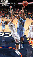 CHARLOTTESVILLE, VA - JANUARY 5: Tierra Ruffin-Pratt #44 of the North Carolina Tar Heels shoots over Jazmin Pitts #21 of the Virginia Cavaliers during the game on January 5, 2012 at the John Paul Jones arena in Charlottesville, Virginia. North Carolina defeated Virginia 78-73. (Photo by Andrew Shurtleff/Getty Images) *** Local Caption *** Jazmin Pitts;Tierra Ruffin-Pratt