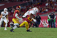 LOS ANGELES, CA - SEPTEMBER 11: Elijah Higgins #6 of the Stanford Cardinal is brought down by Calen Bullock #27 of the USC Trojans after a reception during a game between University of Southern California and Stanford Football at Los Angeles Memorial Coliseum on September 11, 2021 in Los Angeles, California.
