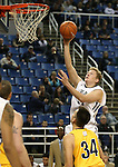 Nevada's Lucas Stivrins drives to the hoop during a college basketball game against  Northwest Christian in Reno, Nev., on Sunday, Dec. 28, 2014. Nevada won 81-67.<br /> Photo by Cathleen Allison