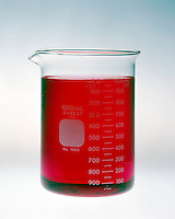 pH COMPARISON OF BUFFERED & UNBUFFERED SOLUTION<br /> (3 of 4)<br /> Buffered Solution Resists  pH Change<br /> Buffered solution of .10M acetic acid, pH 4.74, with methyl red indicator. Indicator is red.  Buffers in solution resist changes in pH by neutralizing the added acid or base with the base or acid component of the buffer.