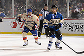 Rochester Amerks winger Dan Catenacci (45) skates up ice behind Lake Erie Monsters defensemen Karl Stollery (3) during the first period of The Frozen Frontier outdoor AHL game at Frontier Field on December 13, 2013 in Rochester, New York.  (Copyright Mike Janes Photography)