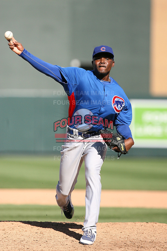 Rafael Dolis #66 of the Chicago Cubs pitches against the Arizona Diamondbacks in a spring training game at Salt River Fields on March 13, 2011 in Scottsdale, Arizona. .Photo by:  Bill Mitchell/Four Seam Images.