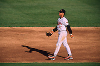 OAKLAND, CA - Roberto Alomar of the Baltimore Orioles walks on the field during a game against the Oakland Athletics at the Oakland Coliseum in Oakland, California in 1996. Photo by Brad Mangin..
