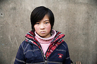 Li Chang, 11, was orphaned in 2006 after her father died of uremia.  Her mother died in 1997 from a cerebral hemorrhage.  The girl now lives with her grandparents in Longju Village, Jiangsu Province, China, and they cannot financially support her continued schooling.  ..Yang Zhou was orphaned in 2003 and now lives with his grandparents in rural Hu He Village, Jiangsu Province, China.  The boy's father died of asthma complications in 2002, and his mother remarried in 2003, abandoning him.  Yang Zhou's grandparents are both over 70 and cannot support him; his grandmother has a gastric illness, and his grandfather has a cerebral embolism and the meager income they earn from farming does not support the family...At the time of these pictures, China's Amity Foundation charity, was investigating the family's situation in preparation to raise money to financially support these children and other orphans in similar situations.  With Amity's support, each orphan, aged 6-12, would receive approximately 1,400 RMB annually (about 200 USD) to pay for the cost of living. Amity works to keep children out of the institutional orphanages in China, preferring to provide monetary assistance that can help maintain a family environment for the orphans it helps.  .