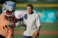 Clearwater Threshers mascot Phinley with Actor Dwier Brown after throwing out the ceremonial first pitch before a Florida State League game between the Charlotte Stone Crabs and Clearwater Threshers on May 17, 2019 at Spectrum Field in Clearwater, Florida.  Charlotte defeated Clearwater 12-4.  (Mike Janes/Four Seam Images)
