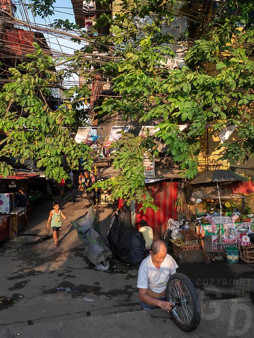 Reparing the wheel, Street Photography, Manila, Philippines