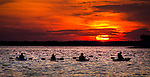Kayakers watch the sunset at Shell Point Beach along the Forgotten Coast of the north Florida panhandle.