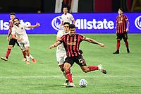 ATLANTA, GA - SEPTEMBER 02: Miles Robinson #12 of Atlanta United FC passes the ball during a game between Inter Miami CF and Atlanta United FC at Mercedes-Benz Stadium on September 02, 2020 in Atlanta, Georgia.
