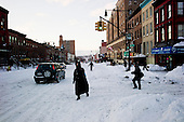Brooklyn, New York<br /> December 27, 2010<br /> <br /> Snow blizzard on the East Coast. Both people and cars move up and down the few plowed streets and avenues towards the end o the first day. On 9th street and 6th avenue the snow is layered with ice and everything slides.