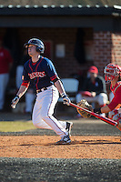 Nick Spangler (22) of the Shippensburg Raiders follows through on his swing against the Belmont Abbey Crusaders at Abbey Yard on February 8, 2015 in Belmont, North Carolina.  The Raiders defeated the Crusaders 14-0.  (Brian Westerholt/Four Seam Images)