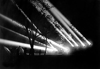 """Mobile anti-aircraft searchlight, used by Engineer Corps.  Night view of illumination from 24"""" searchlights.  Washington Barracks, D.C.  April 17, 1918.  Lt. William C. Fox.  (Army)<br />NARA FILE #:  111-SC-8271<br />WAR & CONFLICT BOOK #:  576"""