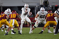 LOS ANGELES, CA - SEPTEMBER 11: Tanner McKee #18 of the Stanford Cardinal takes a snap from Drake Nugent #60 during a game between University of Southern California and Stanford Football at Los Angeles Memorial Coliseum on September 11, 2021 in Los Angeles, California.