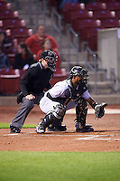Umpire Mac Dietz and Kane County Cougars catcher Eduardo de Oleo (12) during the second game of a doubleheader against the Cedar Rapids Kernels on May 10, 2016 at Perfect Game Field in Cedar Rapids, Iowa.  Cedar Rapids defeated Kane County 3-2.  (Mike Janes/Four Seam Images)