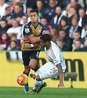 Alexis Sanchez of Arsenal is tackled by Kyle Naughton of Swansea City during the Barclays Premier League match between Swansea City and Arsenal played at The Liberty Stadium, Swansea on October 31st 2015