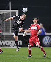 DC United defender Bryan Namoff (26) heads the ball against Chicago Fire forward Brian McBride (20). Chicago Fire tied DC United 1-1 at RFK Stadium, Saturday, March 28, 2009.