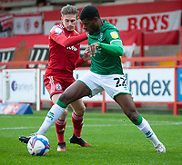 Lincoln City's Timothy Eyoma shields the ball from Accrington Stanley's Joe Pritchard<br /> <br /> Photographer Andrew Vaughan/CameraSport<br /> <br /> The EFL Sky Bet League One - Accrington Stanley v Lincoln City - Saturday 21st November 2020 - Crown Ground - Accrington<br /> <br /> World Copyright © 2020 CameraSport. All rights reserved. 43 Linden Ave. Countesthorpe. Leicester. England. LE8 5PG - Tel: +44 (0) 116 277 4147 - admin@camerasport.com - www.camerasport.com