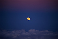 Full Moon seen rising from the summit of Mauna Kea.