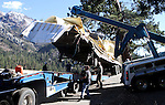 Crews work Tuesday to remove a truck and trailer that crashed over the embankment of Cadillac Curve on Highway 4, south of Markleeville, Ca. on Tuesday, Oct. 12, 2010. The driver survived the accident which left peanut butter chips scattered around the wreckage..Photo by Cathleen Allison