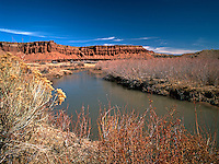 The Colorado River flows through the magnificent red rock country of southern Utah