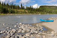 Canoe along the shores of the Nenana river, Interior, Alaska.
