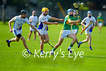 Lixnaw's Eoin Stack on a run as David Chute and Conor Kirby of Tralee Parnells gives chase in the Minor hurling championship quarter final.
