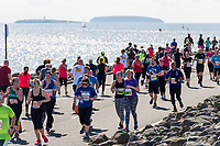 CARDIFF, UK. 2nd April 2017. Participants in the Cardiff Bay Run run along the Cardiff Bay barrage in sunny weather.