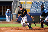 FCL Pirates Black Henry Davis (32) hits a double down the line in the top of the third inning for his first professional hit during a game against the FCL Rays on August 3, 2021 at Charlotte Sports Park in Port Charlotte, Florida.  Davis was making his professional debut after being selected first overall in the MLB Draft out of Louisville by the Pittsburgh Pirates.  Roberto Alvarez (91) catching.  (Mike Janes/Four Seam Images)