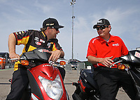 Apr. 7, 2013; Las Vegas, NV, USA: NHRA funny car driver Chad Head (right) talks with Del Worsham during the Summitracing.com Nationals at the Strip at Las Vegas Motor Speedway. Mandatory Credit: Mark J. Rebilas-