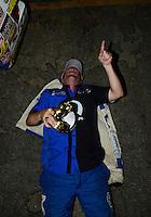 Nov. 11, 2012; Pomona, CA, USA: NHRA pro stock driver Allen Johnson celebrates after winning the Auto Club Finals at at Auto Club Raceway at Pomona. Mandatory Credit: Mark J. Rebilas-
