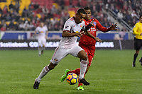 Harrison, NJ - Thursday March 01, 2018: Tyler Adams, Rony Martínez. The New York Red Bulls defeated C.D. Olimpia 2-0 (3-1 on aggregate) during a 2018 CONCACAF Champions League Round of 16 match at Red Bull Arena.