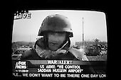 Chicago, Illinois.USA.April 4, 2003..TV images of embedded FOX news reporter entering Baghdad with US forces.